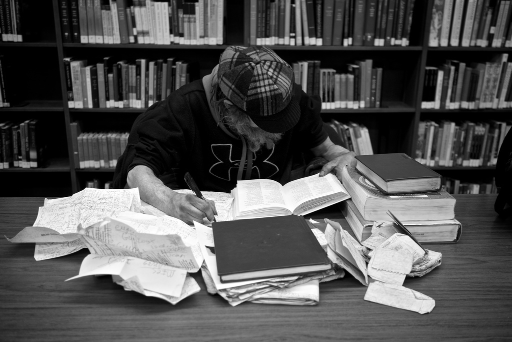 Guy At Library with Abundance of books