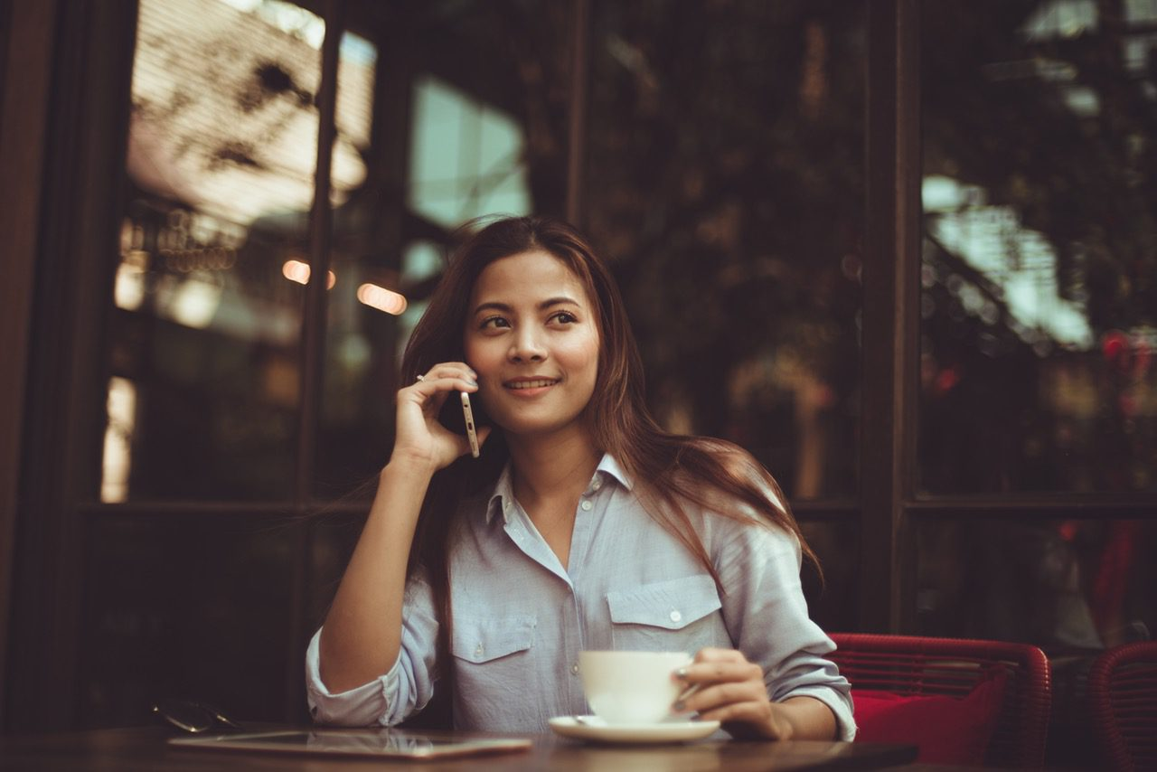 Woman on phone in a cafe