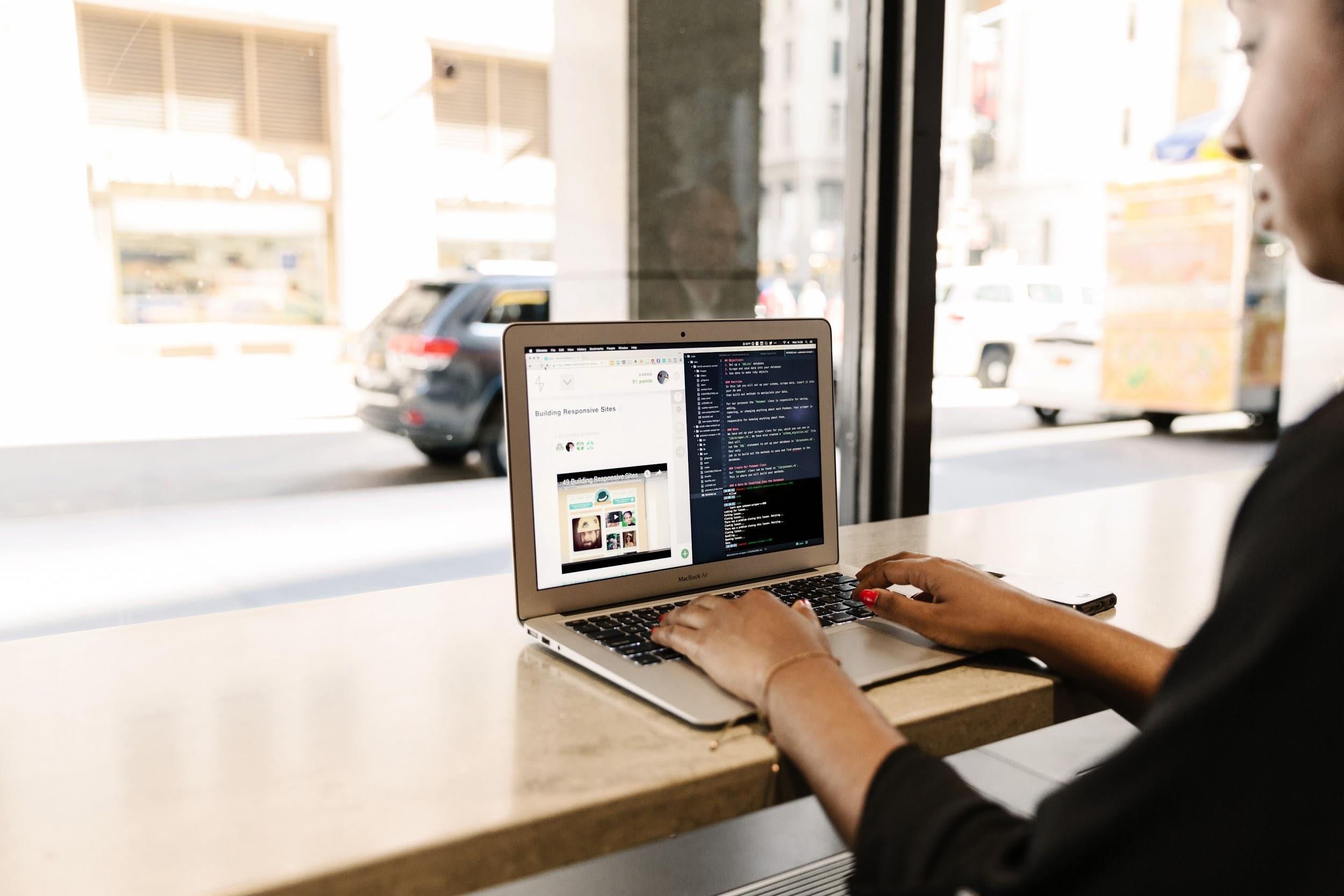 Woman coding on a laptop