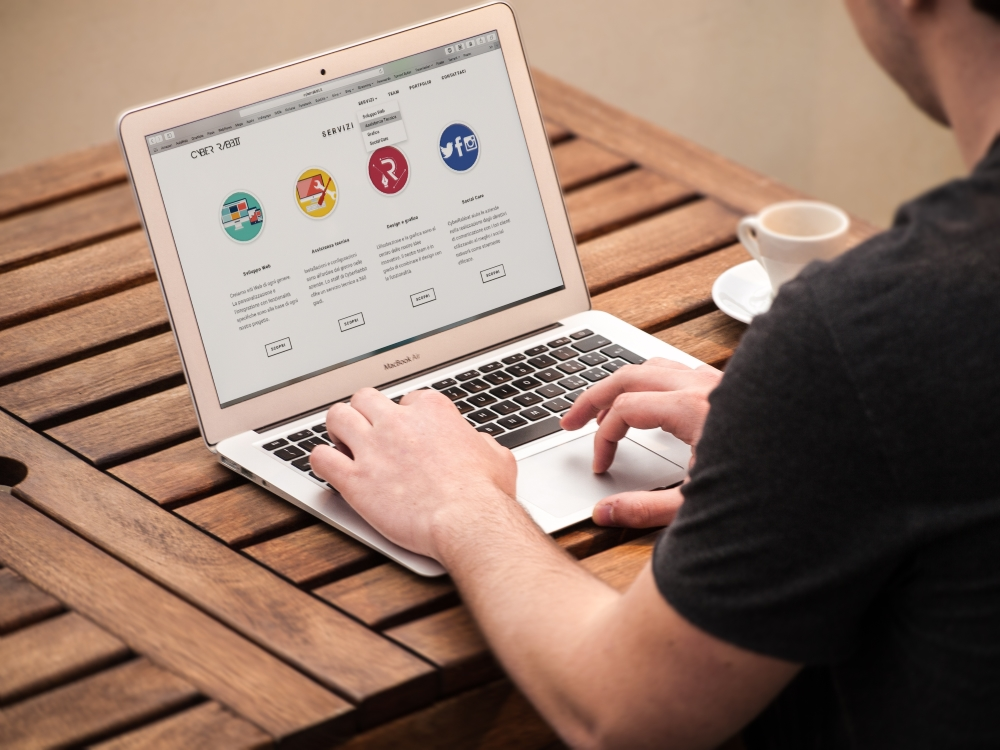 Man with laptop - 6 tips for choosing a web host