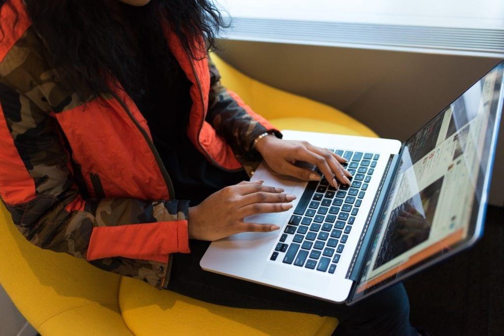 woman on laptop using docker