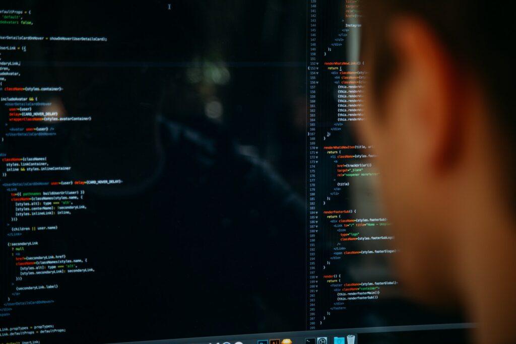 Man coding on computer screen