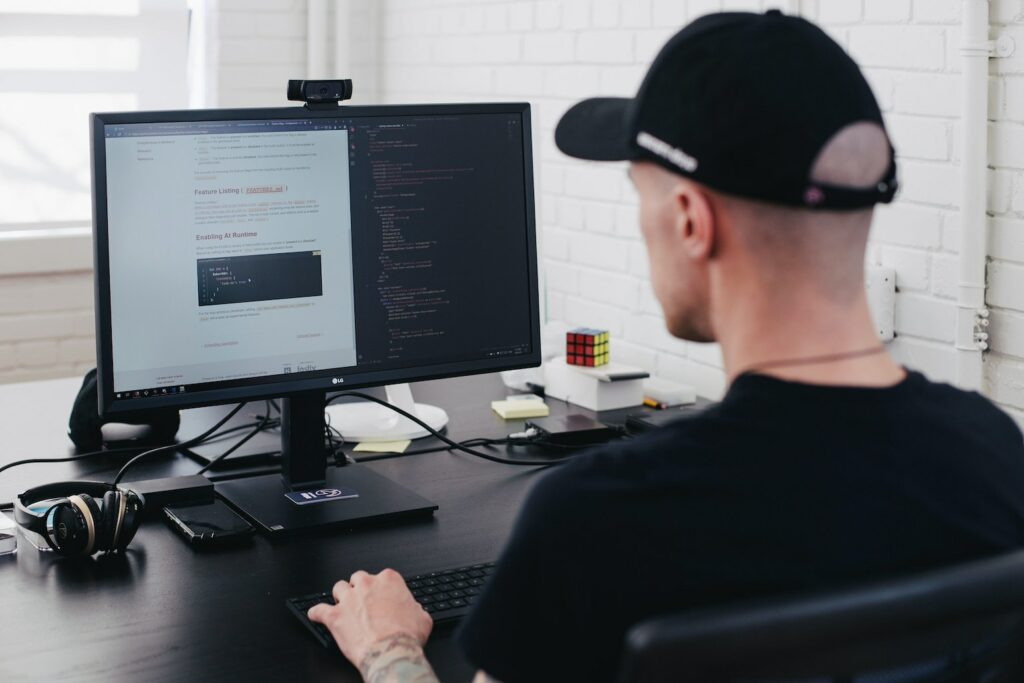 Man typing code on the computer